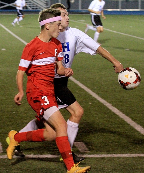 E.L. Hubbard/HEY!Hamilton! Fairfield striker JP Partlow and Hamilton forward Maycol Castillo battle for the ball during their game at Virgil Schwarm Stadium in Hamilton Tuesday. Fairfield won the GMC contest, 1-0.