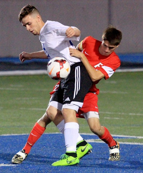 E.L. Hubbard/HEY!Hamilton! Hamilton forward Mark Harris is pressured by Fairfield defender Brady Bell during their game at Virgil Schwarm Stadium in Hamilton Tuesday. Fairfield won the GMC contest, 1-0.