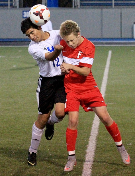 E.L. Hubbard/HEY!Hamilton! Hamilton defender Luis Cruz and Fairfield midfielder Brennan Gallo try to head butt the ball during their game at Virgil Schwarm Stadium in Hamilton Tuesday. Fairfield won the GMC contest, 1-0.