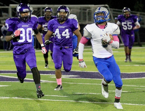 Hey!Hamilton/E.L. Hubbard Hamilton wide receiver A'Shon Riggins escapes the Middletown Middies for a big gain during their game at Barnitz Stadium in Middletown Friday, Oct. 9, 2015. Hamilton ruined the Middies homecoming with a 34-22 win.