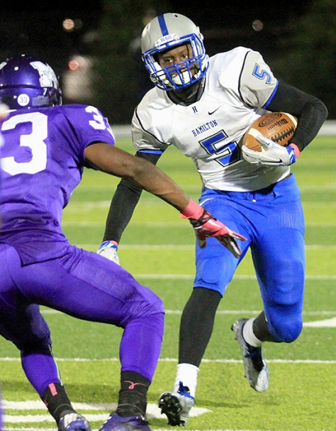 Hey!Hamilton/E.L. Hubbard Hamilton running back Isaiah Murph tries to avoid Middletown defensive back Marquis Petty during their game at Barnitz Stadium in Middletown Friday, Oct. 9, 2015. Hamilton ruined the Middies homecoming with a 34-22 win.