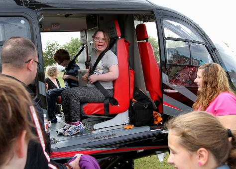 E.L. Hubbard/HEY!Hamilton! Donna Reiff, from Hamilton, enjoys sitting in the UC Health Air Care helicopter during the Heroes Day program, a celebration to show support for local law enforcement, firefighters, military, and EMS, at the Hamilton Christian Center in Hamilton Sunday, September 27, 2015.