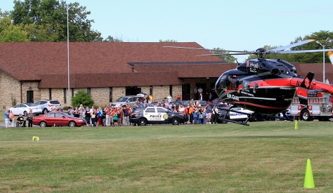 E.L. Hubbard/HEY!Hamilton A UC Health Air Care helicopter lands at the Hamilton Christian Center during the Heroes Day program, a celebration to show support for local law enforcement, firefighters, military, and EMS, at the church in Hamilton Sunday, September 27, 2015.
