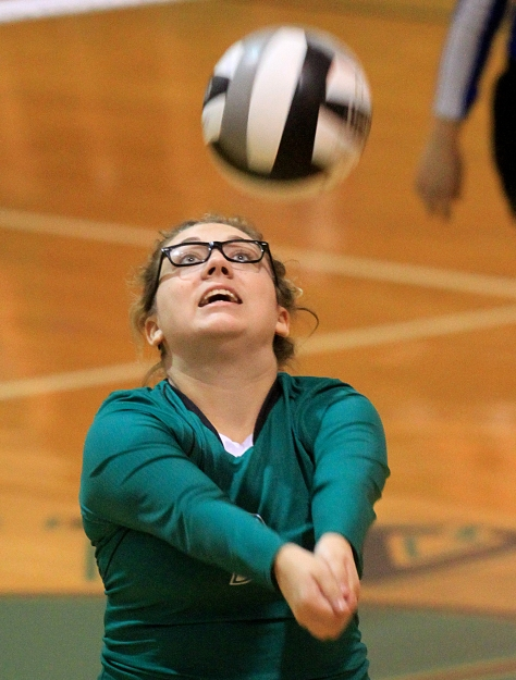 E.L. Hubbard/HEY!Hamilton! New Miami's Kaysee Wagers sets up a shot for a teammate during their game against Cincinnati Christian School at New Miami Monday, September 28, 2015. CCS won 25-12, 25-9, 25-13.