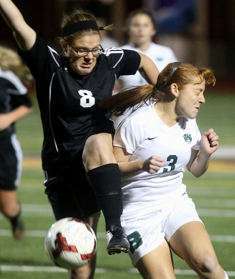 Hey!Hamilton!/E.L. Hubbard Preble Shawnee defender Alexis Blanton and Badin forward/midfielder Maddi Maccio battle for the ball during their Division III sectional girls soccer game at Eaton Monday, Oct. 26, 2015. Badin won the contest, 4-0.