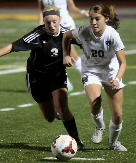 Hey!Hamilton!/E.L. Hubbard Preble Shawnee midfielder Allison Began and Badin midfielder/forward Jamie Lehker battle for the ball during their Division III sectional girls soccer game at Eaton Monday, Oct. 26, 2015. Badin won the contest, 4-0.