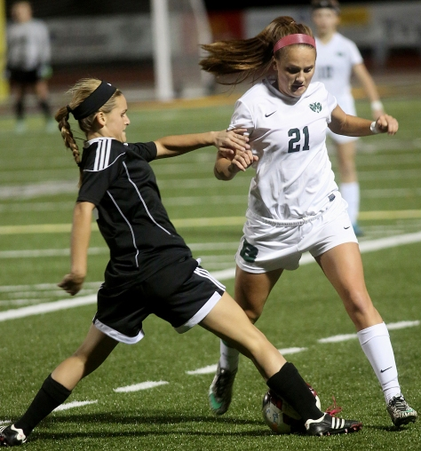 Hey!Hamilton!/E.L. Hubbard Preble Shawnee midfielder Jenna Lovely tries to move the ball past Badin defender Katie Pohlman during their Division III sectional girls soccer game at Eaton Monday, Oct. 26, 2015. Badin won the contest, 4-0.