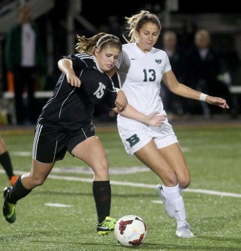 Hey!Hamilton!/E.L. Hubbard Preble Shawnee defender Hope Ballinger and Badin Midfielder Maria Berkely battle for the ball during their Division III sectional girls soccer game at Eaton Monday, Oct. 26, 2015. Badin won the contest, 4-0.