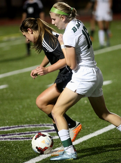 Hey!Hamilton!/E.L. Hubbard Badin midfielder Maddie Smith tries to take the ball from Preble Shawnee defender Ashton Collins during their Division III sectional girls soccer game at Eaton Monday, Oct. 26, 2015. Badin won the contest, 4-0.