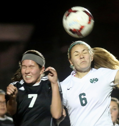 Hey!Hamilton!/E.L. Hubbard Preble Shawnee midfielder Carlee Jones and Badin midfielder/forward Marissa Kah try to head the ball during their Division III sectional girls soccer game at Eaton Monday, Oct. 26, 2015. Badin won the contest, 4-0.