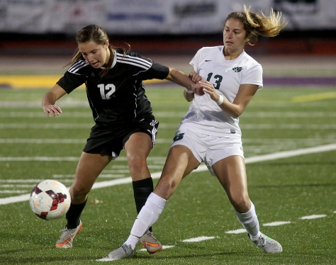 Hey!Hamilton!/E.L. Hubbard Preble Shawnee defender Ashton Collins and Badin midfielder Malia Berkely fight for the ball during their Division III sectional girls soccer game at Eaton Monday, Oct. 26, 2015. Badin won the contest, 4-0.